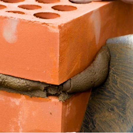 Image of two orange bricks with mortar inbetween them