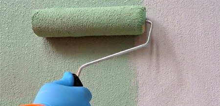 A close up image of the K Rend R10 Bonding Aid being applied to a wall.