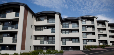Image of a block of buildings that have been rendered with the K Rend Silicone TC15 product.